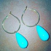 Cerchi con pendente azzurro