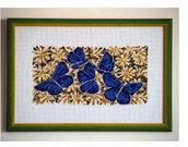 Farfalle blu su margherite