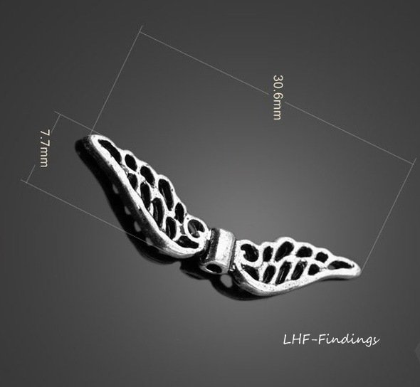 "Charm ""Angel Wings"" color argento (32x7mm) (cod. new)"