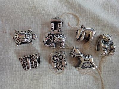7 Perle foro largo PD color argento vari soggetti e misure
