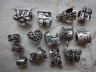 14 Perle foro largo PD color argento vari soggetti e misure