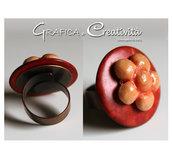 Anello regolabile con bottone in legno arancio