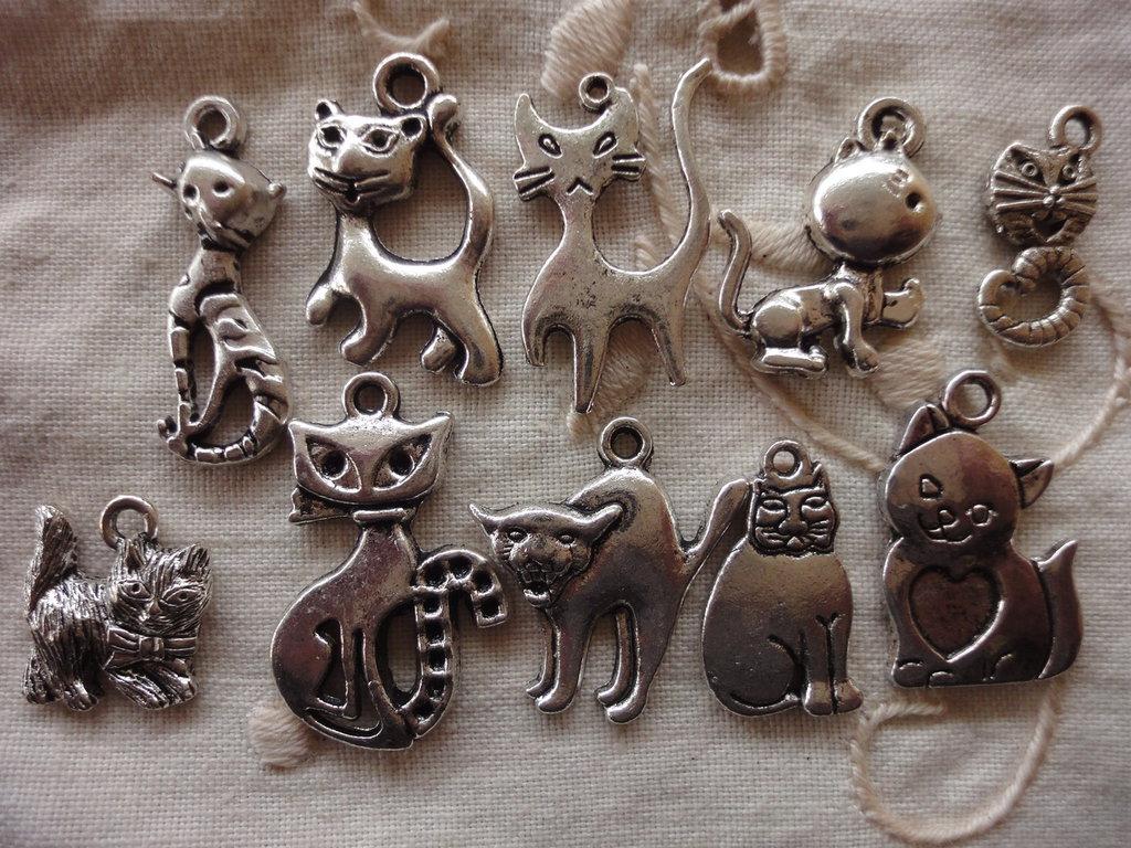 10 Gattini in Metallo color argento di diversi modelli