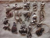 13 Gattini in Metallo color argento di diversi modelli