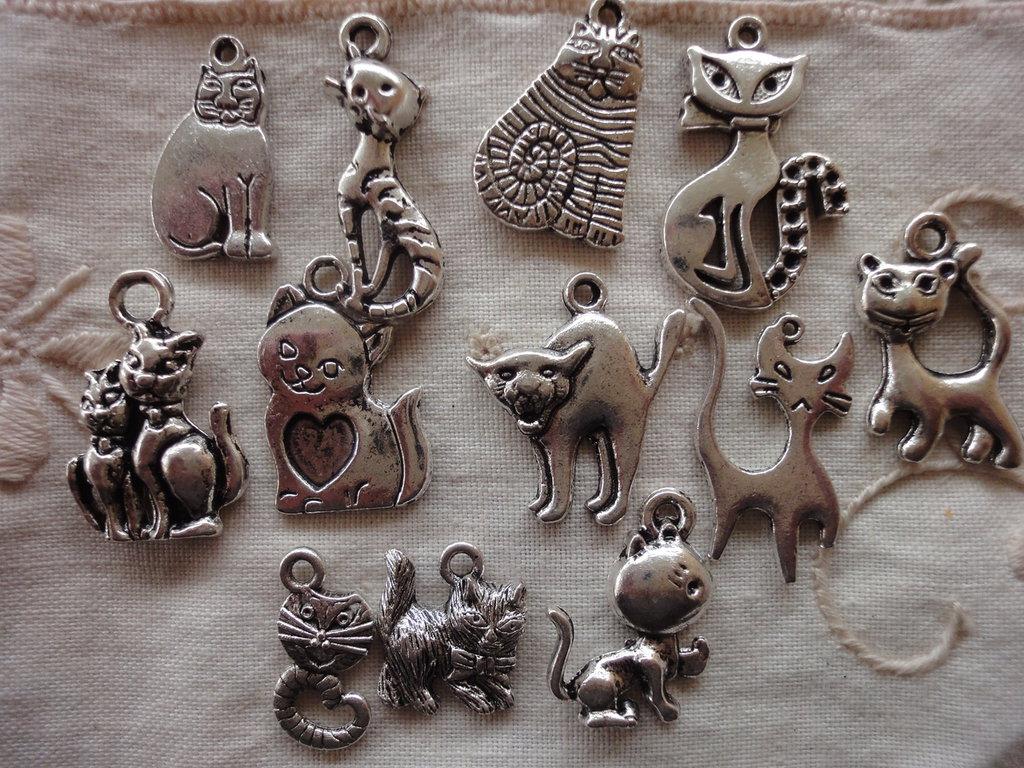 12 Gattini in Metallo color argento di diversi modelli