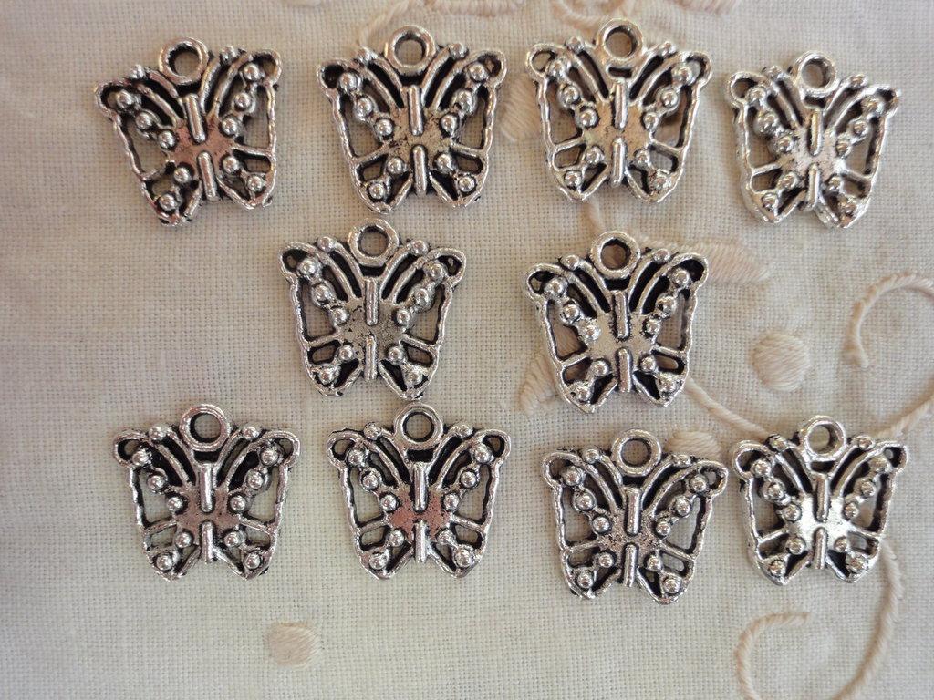 10 Farfalle in Metallo color argento 16x15 mm.