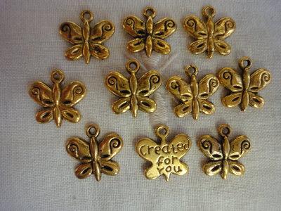 10 Farfalle in Metallo color oro 13x13 mm.