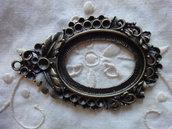1 Cornice metallo color bronzo 68x43 mm. misura interna 32x27 mm