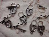 6 Chiusure metallo color argento serratura 21x11mm. chiave 20x5 mm.