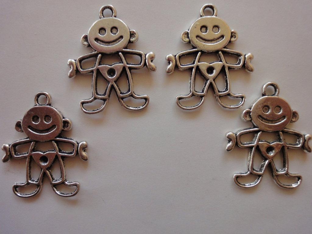 4 Ciondoli  Neonato in metallo color argento 28x23 mm.