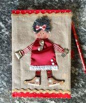 quaderno di pelle decorato con bambolina