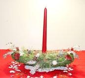 Centro tavola con una candela rossa