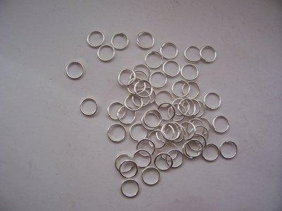 200 anelli color argento da 5 mm.