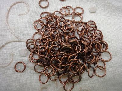200 anelli color rame da 6 mm.