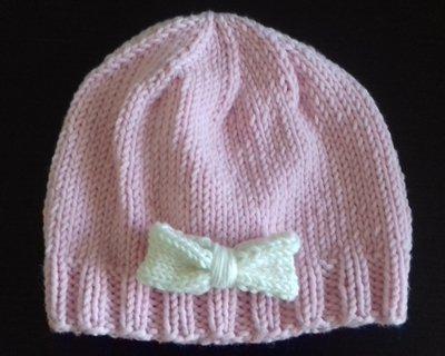 CAPPELLO per bambina in pura lana merino con FIOCCO applicato