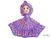 Presina bambola lilla all'uncinetto