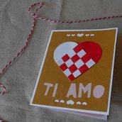 Biglietto innamorato per San Valentino • Cuore di carta intrecciato