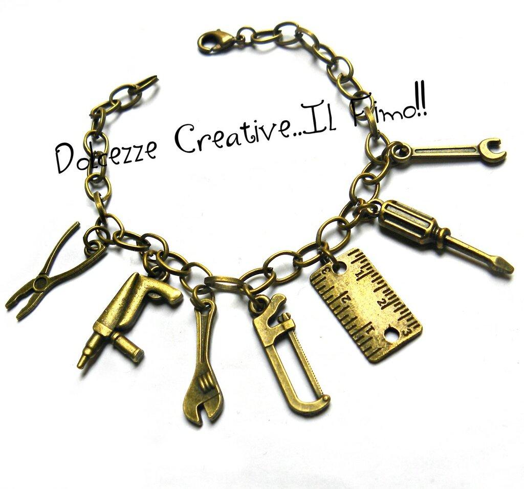 Bracciale Uomo - meccanico - idraulico - carpentiere - pinze, pistola sparachiodi, chiave, sega, metro, cacciavite e chiave