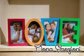 Cornice per fotografie sagomata nella scritta Love in vari colori