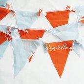 Bandierine in stoffa arancioni e celesti per decorare la vostra festa a tema circo