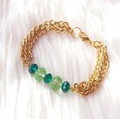 Bracciale con catenella dorata e cristalli verdi