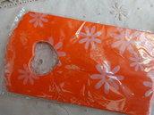 25 bustine plastica arancioni  con fiori 15x9 cm.