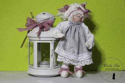 Lanterna con bambola