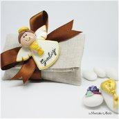 Angelo in pasta di mais con calamita e sacchetto in lino. handmade. Bomboniera prima comunione