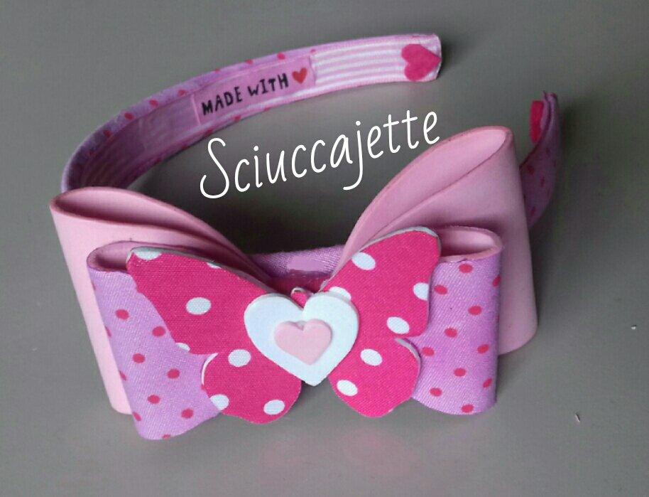 Cerchietto gradazioni di rosa con grande fiocco e farfalla