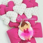 Un fiocco nascita fucsia e bianco con tanti cuori ed una graziosa ballerina per la piccola Penelope