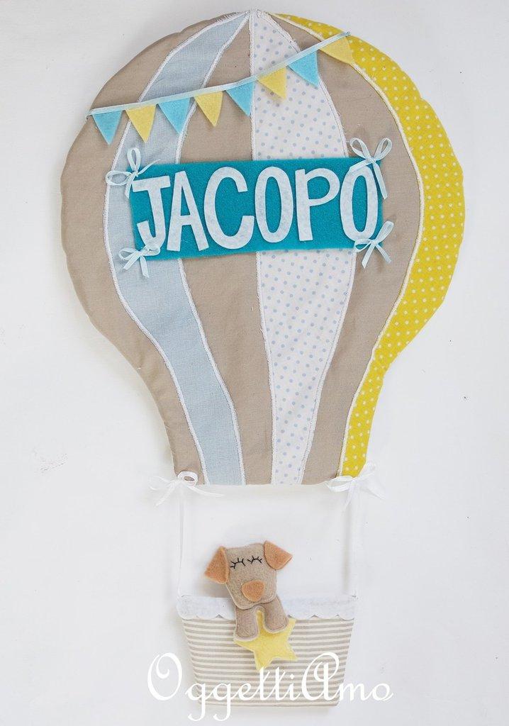Una mongolfiera con cucciolo per annunciare l'arrivo del piccolo di caso: un fiocco nascita originale per decorare la sua cameretta