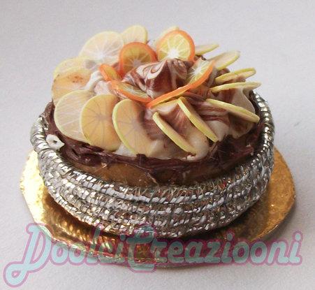 Mini Torta cioccolatosa con fettine di arance e limone