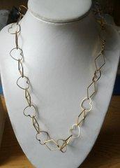 Parure in metallo dorato,collana,bracciale e orecchini