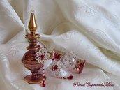 Orecchini color argento al chiacchierino, perline e cristalli rosso rubino