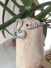 Bracciale in alluminio con scritta
