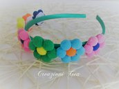 Cerchietto con fiori pon pon colorati