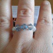 Anello bianco opaco e cristallo bicono  azzurro