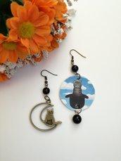 Gattini Renè Magritte orecchini di carta pendenti con perla nera
