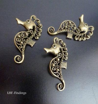 """Charm """"Cavalluccio marino"""" color bronzo (50*26*3mm circa) (cod. new)"""
