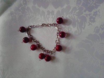 braccialetto con perle rosse