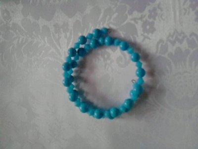 bracciale a spirale con perle azzurre