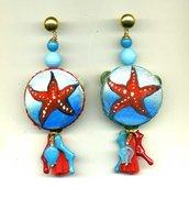 ORECCHINI pendenti con tamburello vero e stella marina rossa