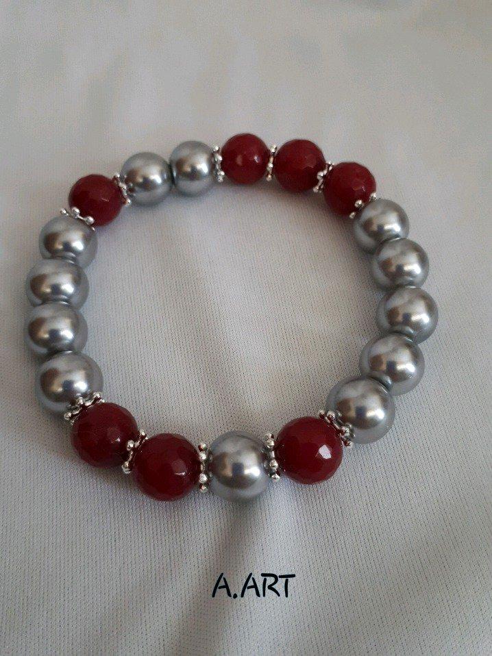 Bracciale perle argento lucido e pietre rosse