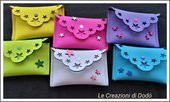 Pochette in neoprene bicolore con stelle