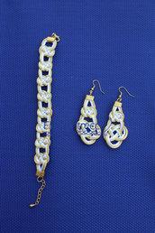 parure bracciale e orecchini a nodi color bianco e oro