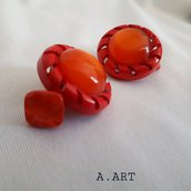 Gemelli per camicia con bottoni arancio e rosso