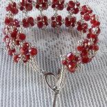 Il braccialetto rosso ed argento