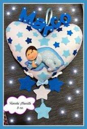 fiocco nascita bambino sul cuore