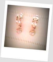 Luminosi orecchini vintage con perno e cristalli