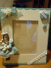 portafoto con bambolina